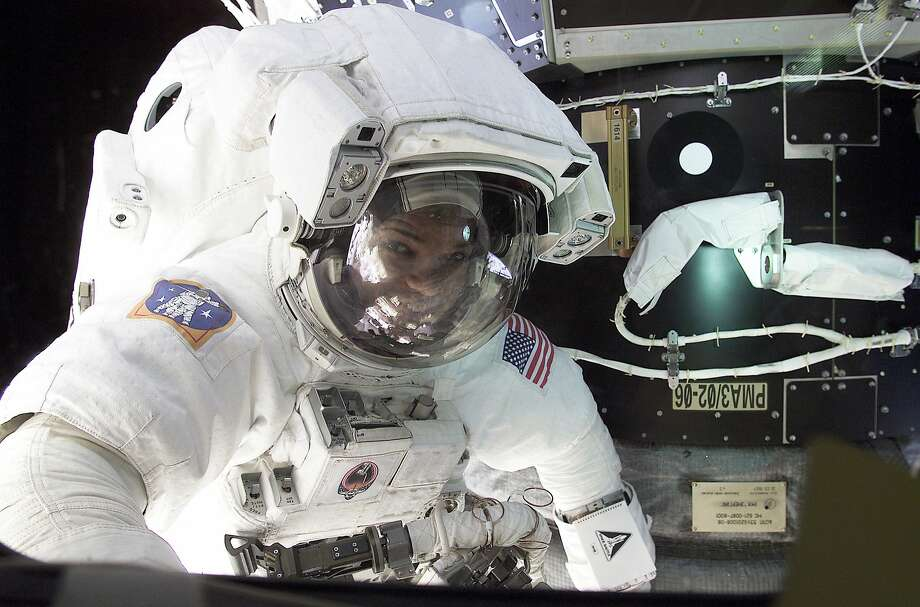 Astronaut Robert Curbeam had a valve leak and spilled toxic ammonia all over his space suit during a space walk in 2001. Photo: Associated Press