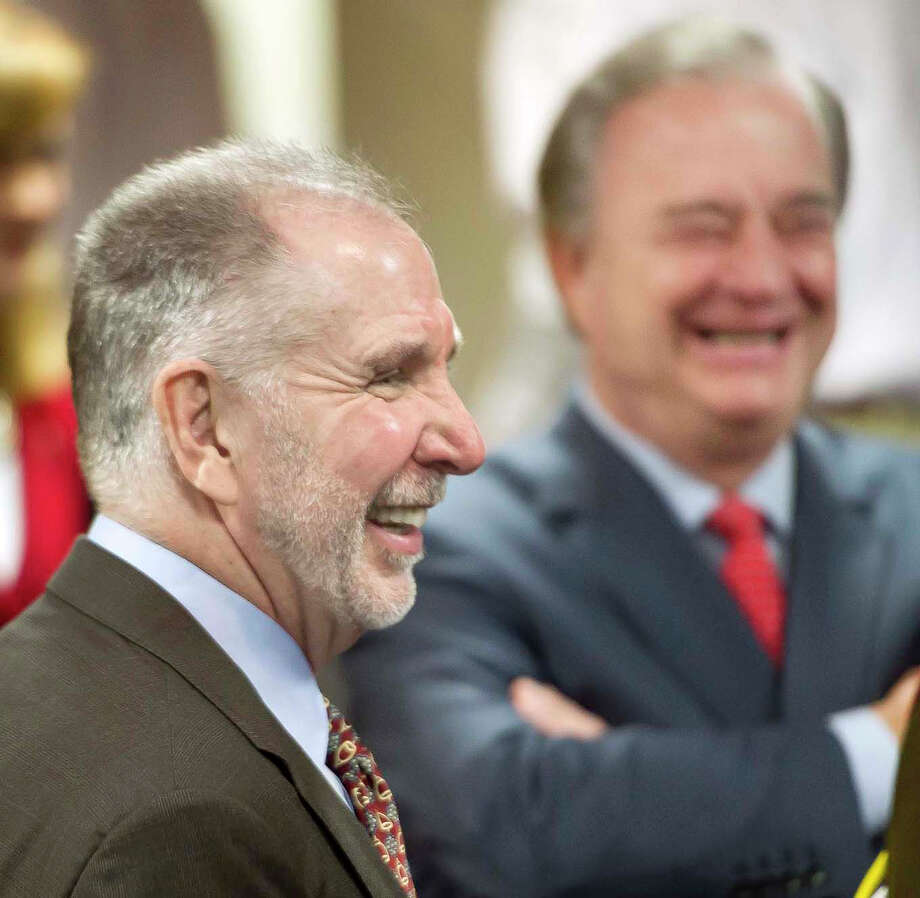 Michael K. Young (left), newly appointed president of Texas A&M University , laughs with Texas A&M System Chancellor John Sharp during a news conference about the campaign in College Station. Photo: Dave McDermand / AP / College Station Eagle