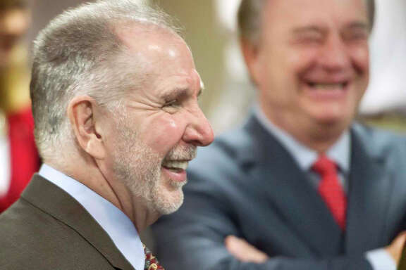 Michael K. Young (left), newly appointed president of Texas A&M University , laughs with Texas A&M System Chancellor John Sharp during a news conference about the campaign in College Station.