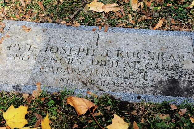 The grave of Joseph J. Kucskar, a WWII soldier who walked the Bataan Death March and died in the Philippines in 1943, at St Agnes Cemetery on Thursday Nov. 5, 2015 in Menands, N.Y.  (Michael P. Farrell/Times Union) Photo: MICHAEL P. FARRELL / 00034093A