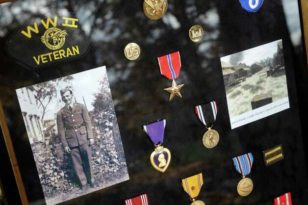 The medals of Joseph J. Kucskar, a WWII soldier who walked the Bataan Death March and died in the Philippines in 1943, graveside at St Agnes Cemetery on Thursday Nov. 5, 2015 in Menands, N.Y.  (Michael P. Farrell/Times Union) Photo: Michael P. Farrell / 00034093A