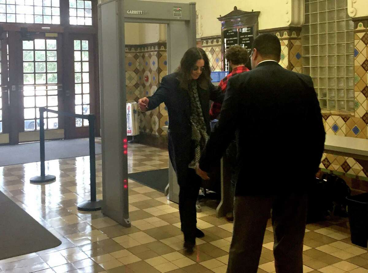 Famed rocker Ozzy Osbourne walks through security at City Hall in San Antonio where he was to meet with Councilman Roberto Trevino on Thursday, November 5, 2015. Osbourne is expected to apologize on camera for urinating on the Alamo Cenotaph in 1982.