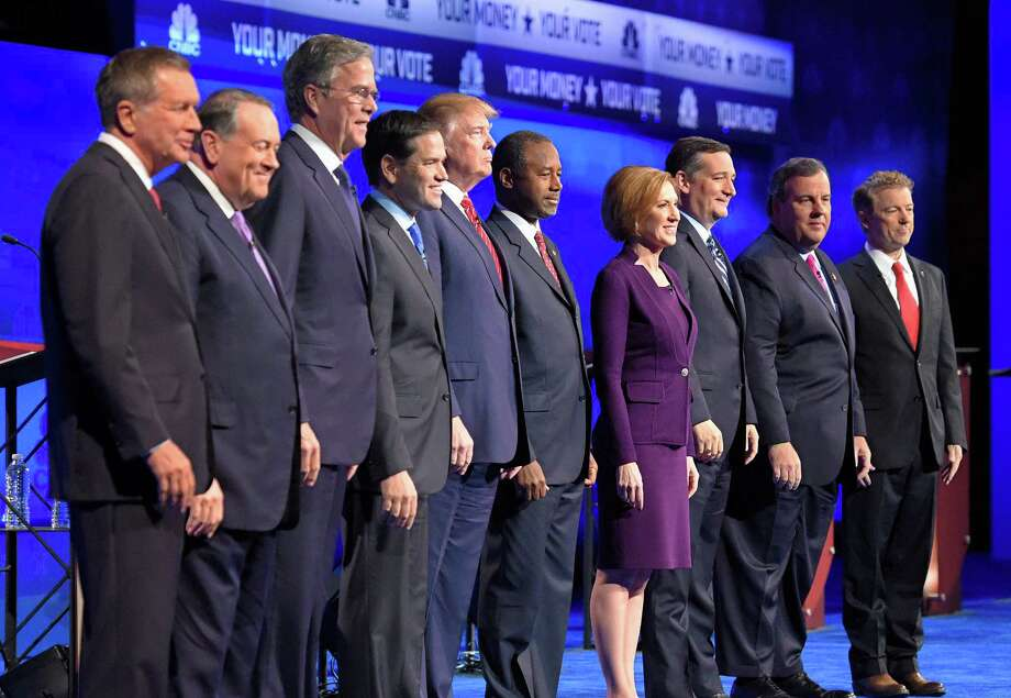 In this photo taken Oct. 28, 2015, Republican presidential candidates, from left, John Kasich, Mike Huckabee, Jeb Bush, Marco Rubio, Donald Trump, Ben Carson, Carly Fiorina, Ted Cruz, Chris Christie, and Rand Paul take the stage during the CNBC Republican presidential debate at the University of Colorado, in Boulder, Colo. Christie could be relegated off the main stage at next week's GOP presidential debate and Bobby Jindal and George Pataki risk being shut out altogether, as the trio become potential victims of their poor showings in preference polling and how those polls are being used. (AP Photo/Mark J. Terrill) Photo: Mark J. Terrill, STF / AP