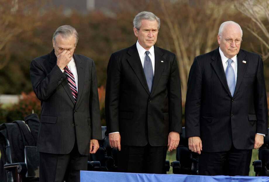 Secretary of Defense Donald Rumsfeld, left, pauses as President George W. Bush and Vice President Dick Cheney participate in Rumsfeld's farewell ceremony at the Pentagon in 2006. Photo: J. Scott Applewhite, STF / AP