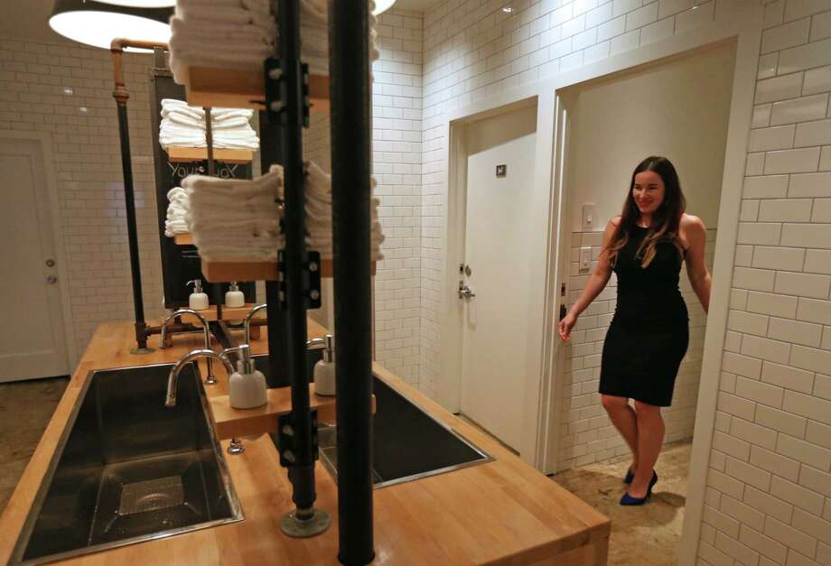 "Britany Devlin uses the communal bathroom at The Pass & Provisions restaurant Thursday, Nov. 5, 2015, in Houston, Texas. ""To me it wasn't a bathroom ordinance, it was an equal rights ordinance,"" said Devlin. ""I love the bathroom here, it has closed stalls."" The doors, marked with a W for women and M for men, lead to a private individual restroom with a communal wash area.  ( Gary Coronado / Houston Chronicle ) Photo: Gary Coronado, Staff / © 2015 Houston Chronicle"
