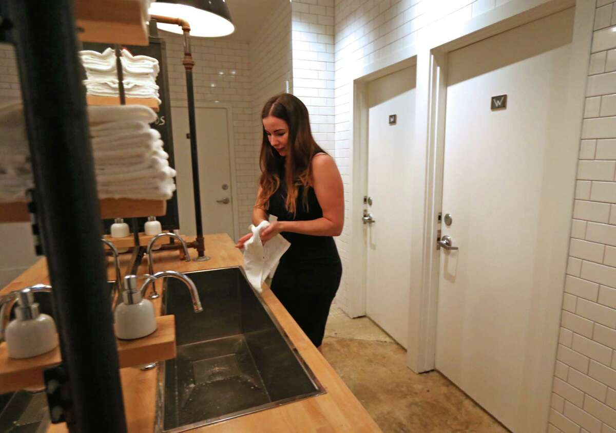 Britany Devlin uses the communal bathroom at The Pass & Provisions restaurant on Thursday.