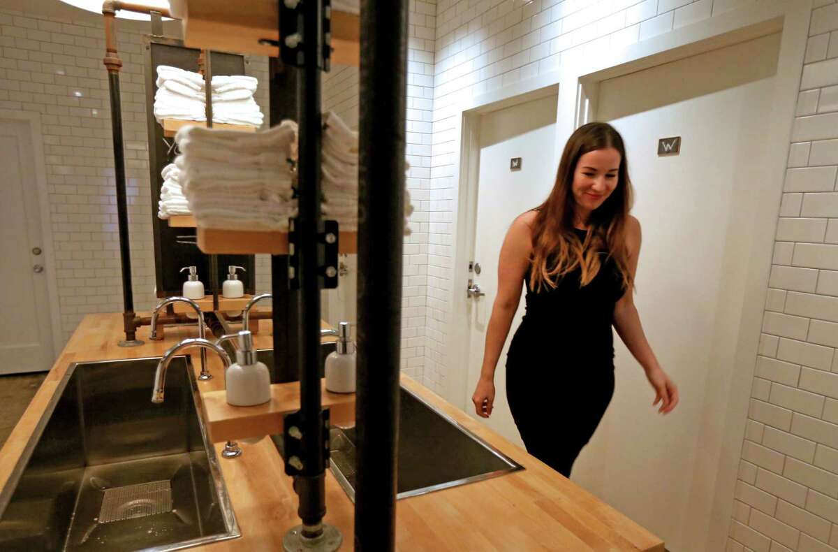 Britany Devlin uses the communal bathroom at The Pass & Provisions restaurant Thursday, Nov. 5, 2015, in Houston, Texas.