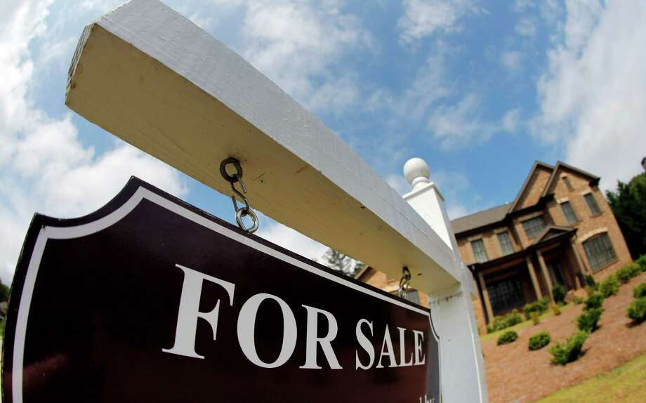 Although the San Antonio housing market was up in October compared to a year ago, both total sales and median prices dipped compared to September, which is normal during the fall and winter months, real estate experts say. Photo: John Bazemore /Associated Press / AP