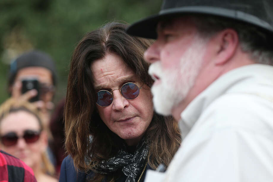 Rocker Ozzy Osbourne visited the Alamo Thursday for a tour after he was arrested in February 1982 for urinating on the landmark's Cenotaph.  Photo: JERRY LARA, Staff / © 2015 San Antonio Express-News