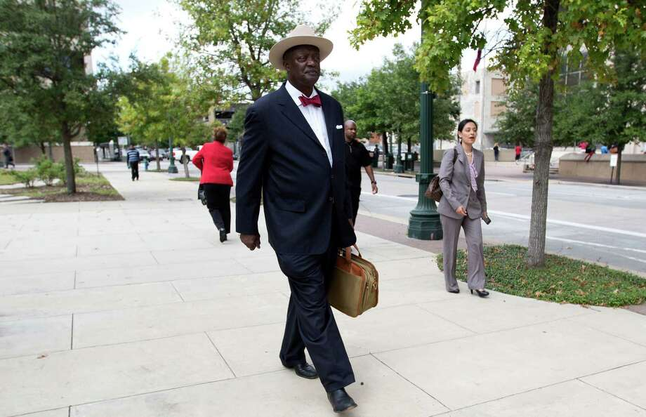 Former appellate judge Morris Overstreet walks down the sidewalk after announcing his candidacy for the Democratic nomination for district attorney. Photo: Cody Duty, Staff / © 2015 Houston Chronicle