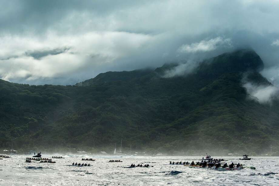 Participants exit the Huahine pass in the direction of Raiatea on the morning of November 4, 2015 for the first leg of the Hawaiki Nui Va'a 2015 outrigger canoe race. The Hawaiki Nui Va'a outrigger canoe race is an annual event with more than 100 team of intense racing between Huahine, Raiatea, Taha'a and Bora Bora, honoring an ancient sport with great cultural values. The 24th edition of the race hosts teams from Taihiti, France and New Zealand, with the number of teams and countries increasing each year. Originally made in wood, almost all of the canoes are today fabricated with high tech polyester material and carbon fiber. Photo: Gregory Boissy, AFP / Getty Images