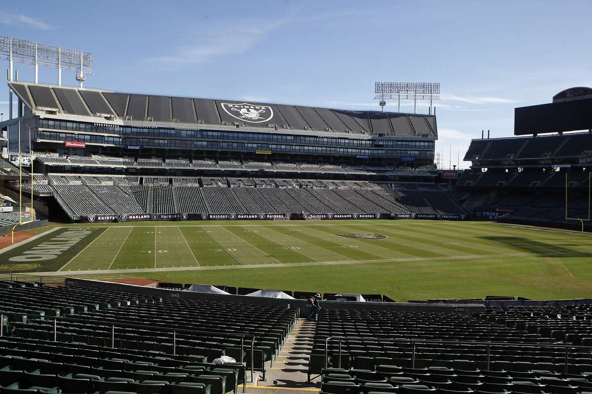 One of the custodial staff cleans inside the O.co Coliseum, Oakland Calif. on November 5, 2015. The 49-year old stadium is the last of it's kind as a convertible venue for playing both football and baseball. Currently home to the Oakland Athletics and the Oakland Raiders, both teams are seeking to leave the facilities.