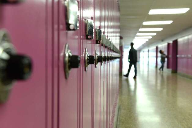 School lockers and hallway at Shaker Junior High School Monday, Oct. 26, 2015, in Colonie, N.Y. The number of students who completed high school in New York this year is down from one year ago, according to new data from the state Education Department. (Will Waldron/Times Union archive) Photo: Will Waldron / 00033940A