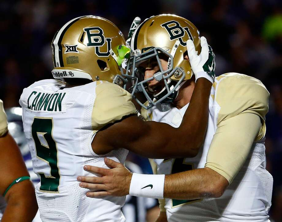 MANHATTAN, KS - NOVEMBER 05:  Quarterback Jarrett Stidham #3 of the Baylor Bears is congratulated by wide receiver KD Cannon #9 after scoring a touchdown during the 1st quarter of the game against the Kansas State Wildcats at Bill Snyder Family Football Stadium on November 5, 2015 in Manhattan, Kansas.  (Photo by Jamie Squire/Getty Images) Photo: Jamie Squire, Getty Images