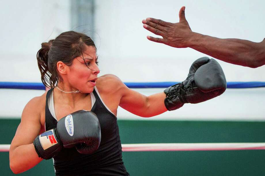 Boxer Marlen Esparza is left trying to figure out what might have been after losing twice in the Olympic Trials last month in Memphis, Tenn. Photo: Smiley N. Pool, Staff / © 2012  Houston Chronicle