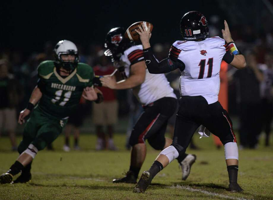 Kirbyville's Jackson Gore steps back to throw the ball against the Buccaneers during a match up at the East Chamber's field Thursday night.  Photo taken Wednesday, November, 4, 2015  Guiseppe Barranco/The Enterprise Photo: Guiseppe Barranco, Photo Editor
