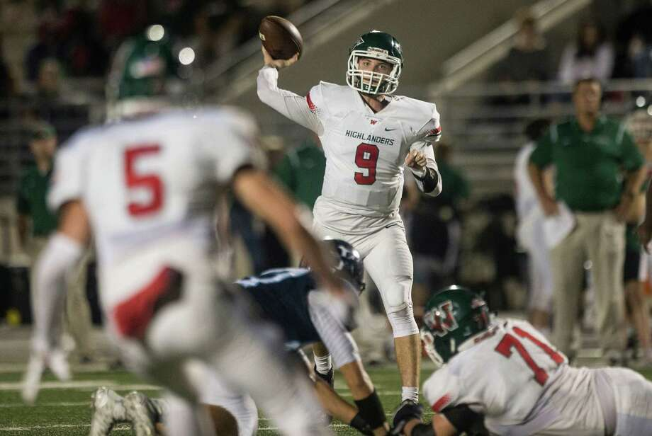The Woodlands quarterback Harry Woodberry (9) throws a touchdown pass to receiver Reed Barber during last week's win over Kingwood. Photo: Brett Coomer, Staff / © 2015  Houston Chronicle