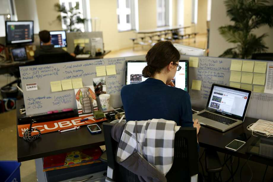 Lyndsey Powers works at her desk in The Cube's offices in San Francisco, California, on Thursday, Nov. 5, 2015. Photo: Connor Radnovich, The Chronicle