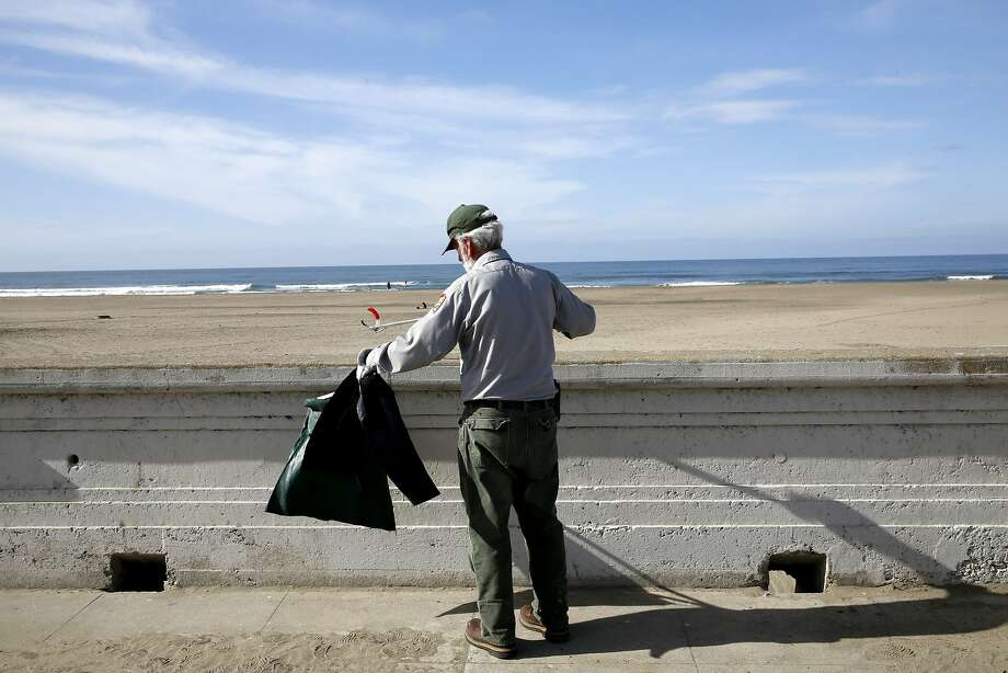 Maintenance worker James Brown picks up trash at Ocean Beach in San Francisco, California, on Thursday, Nov. 5, 2015. Photo: Connor Radnovich, The Chronicle