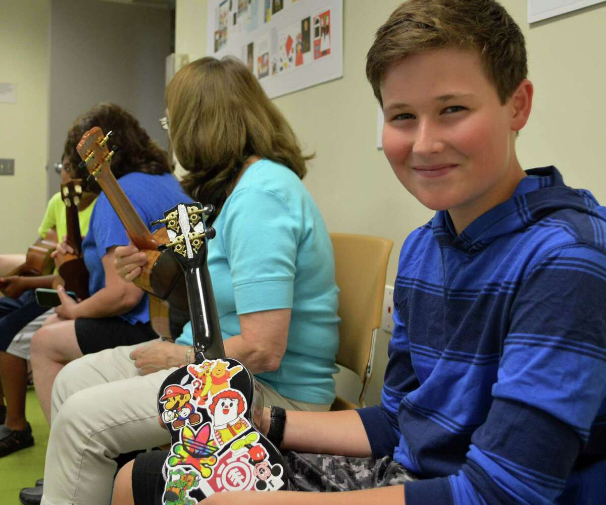 Zach Rosenberg, 14, of Westport, who has personalized his ukulele, at a session of the Ukulele Meetup group at the Westport Library.