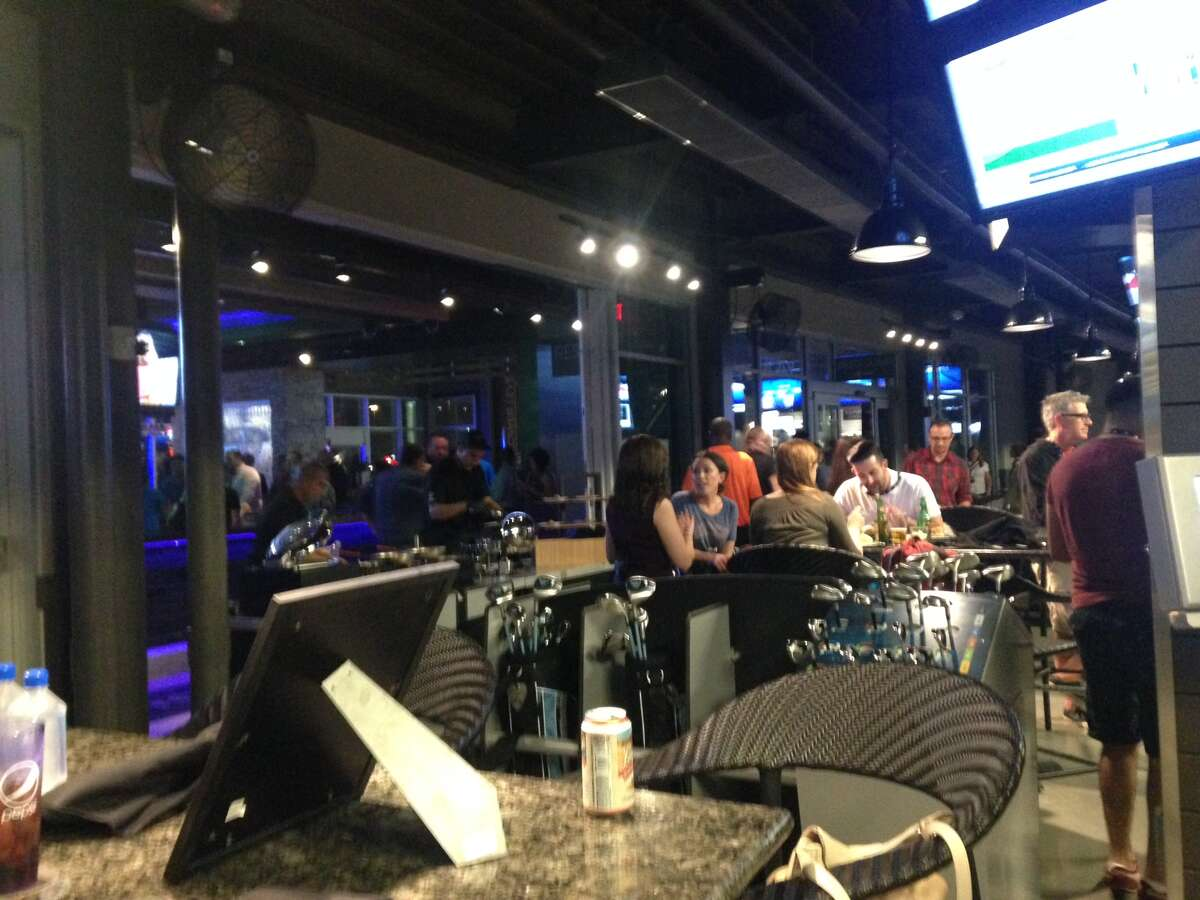 The new TopGolf in Webster has more than 100 bays for visitors to swing away, as well as, eat and drink with a group.