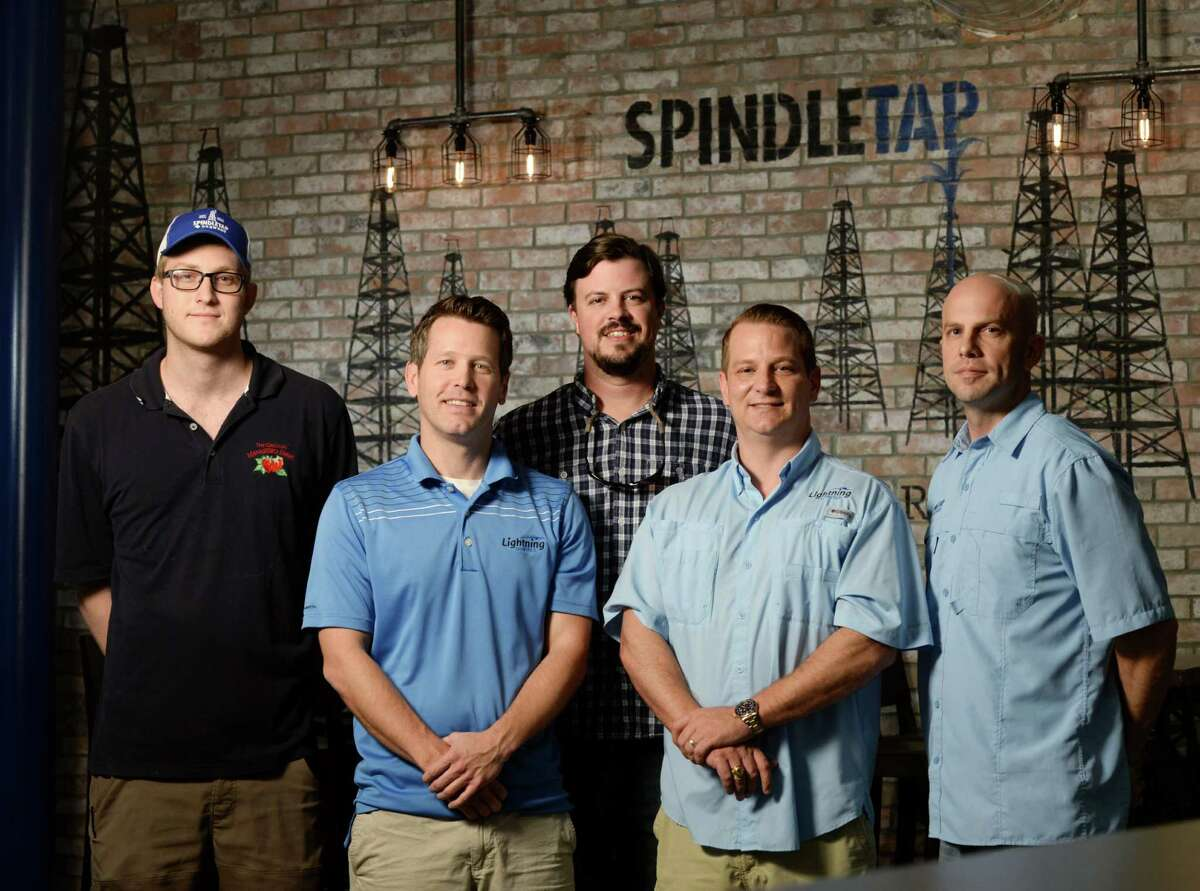 From left, Garrison Mathis, Operations Manager, David Miller, partner, Cameron Banks, partner, Brody Chapman, partner, and Adam Wright, partner, pose for a portrait at Spindletap brewery Thursday, Nov. 5, 2015, in Houston.