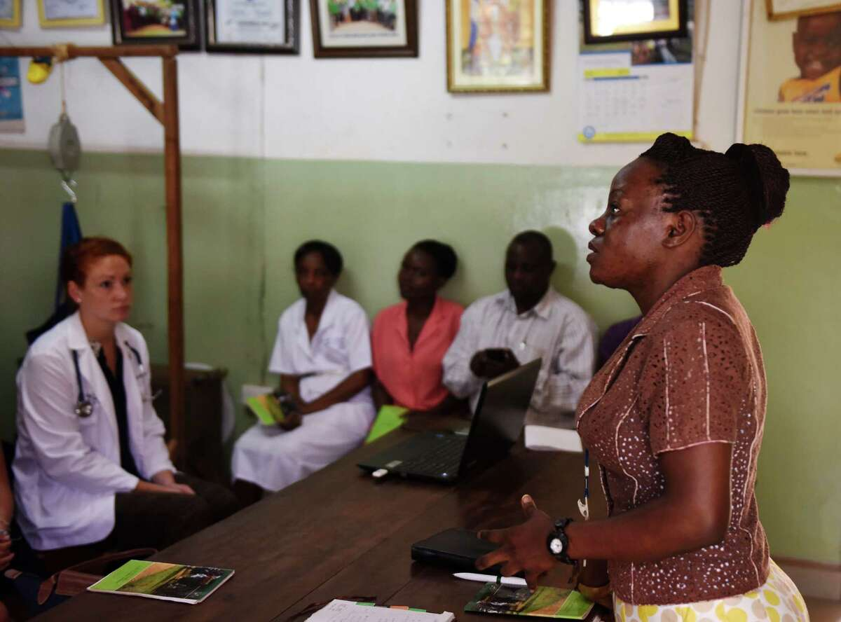 The St. Stephen's Hospital staff holds a short prayer service before beginning the work day at the hospital in the Mpererwe village of Kampala, Uganda.