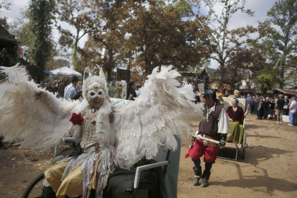 Festival actors parade through the crowd at the Texas Renaissance Festival Saturday, Nov. 29, 2014, in Todd Mission. Sunday is the last day for the festival this year. ( Johnny Hanson / Houston Chronicle )