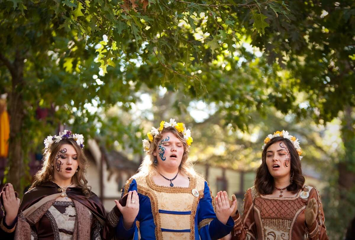 A street madrigal choir performs for Texas Renaissance Festival visitors, Sunday, Oct. 28, 2012, in Todd Mission. The festival will continue until November 25th. ( Nick de la Torre / Houston Chronicle ) MANDATORY CREDIT ¥ PHOTOGRAPHER CONTACT - Nick de la Torre - nick.dela torre@chron.com