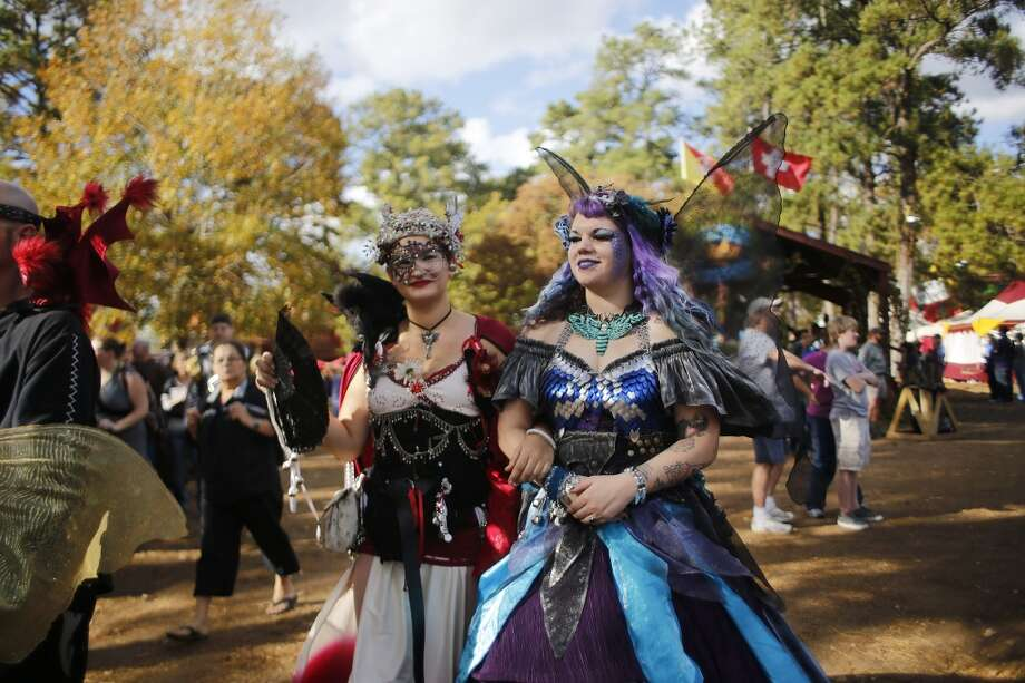 In full festival regalia, Amanda Lee, right, walks with her friend who goes by the name Jaded Kitty Kimiko  at the Texas Renaissance Festival Saturday, Nov. 29, 2014, in Todd Mission. Sunday is the last day for the festival this year. Festival goers celebrated the theme Celtic Christmas. ( Johnny Hanson / Houston Chronicle )