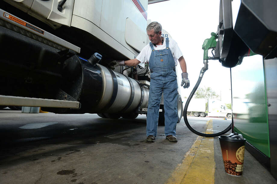 Ronnie Reynolds, 65, fills his tractor trailer with gasoline on Thursday. Lifestyle, age, and other career opportunities are said to be causing a current shortage of truck drivers.  Photo taken November 5, 2015  Guiseppe Barranco/The Enterprise Photo: Guiseppe Barranco, Photo Editor
