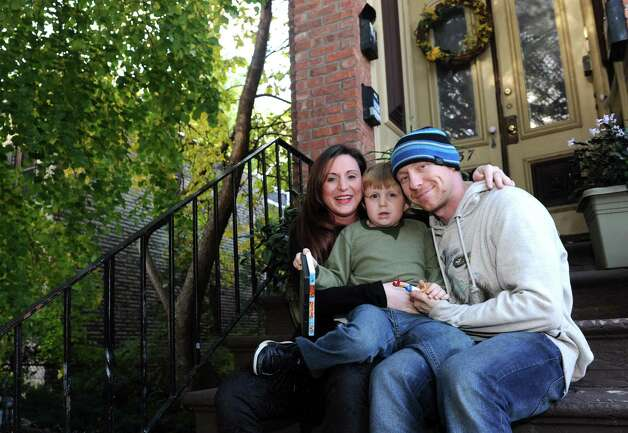 Erin Brueneau, left, and Chris Reeves, right, with their seven-year-old son Christopher on Thursday Oct. 28, 2015 in Albany, N.Y. (Michael P. Farrell/Times Union) Photo: Michael P. Farrell / 00033983A