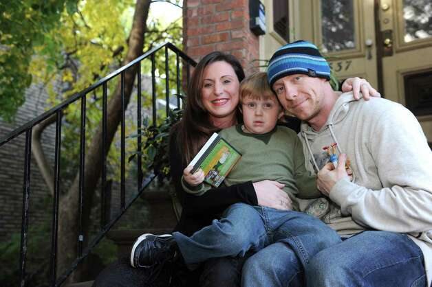 Erin Brueneau, left, and Chris Reeves, right, with their 7-year-old son Christopher on Thursday Oct. 28, 2015 in Albany, N.Y. (Michael P. Farrell/Times Union) Photo: Michael P. Farrell / 00033983A