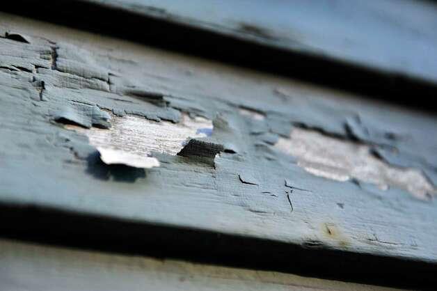 Paint peels off a building on Main Street on Wednesday, Nov. 4, 2015, in Ravena, N.Y.   (Paul Buckowski / Times Union) Photo: PAUL BUCKOWSKI / 00034092A