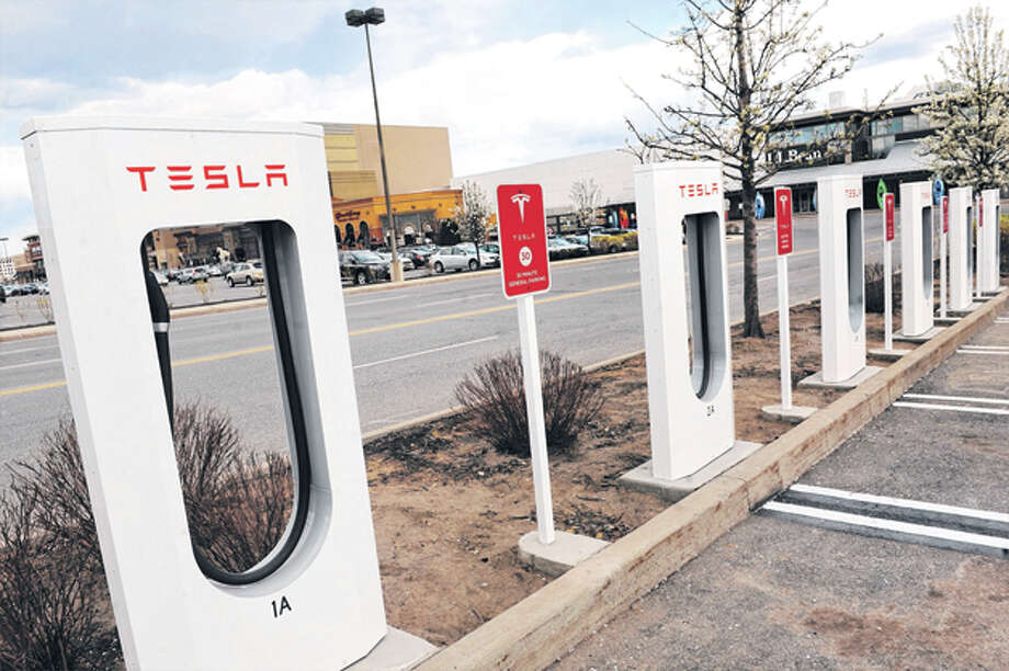 These Tesla charging stations are now operable at Colonie Center. The electric car manufacturer claims you can drive across country without using a drop of gas.  (Cindy Schultz / Times Union) Photo: Cindy Schultz