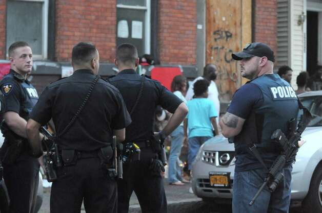 Police continue their investigation of the weekend shooting of two Troy police offices, Joshua Comitale and Chad Klein. in the Lansingburgh area of Troy while trying to apprehend 39-year-old Thaddeus Faison of Albany on Tuesday Aug. 25, 2015 in Troy, N.Y.  (Michael P. Farrell/Times Union) Photo: Michael P. Farrell / 00033124A
