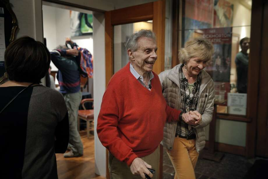 Mort Sahl leaves the stage, helped by Lucy Mercer, after a weekly performance at Mercer's Throckmorton Theatre in Mill Valley. Photo: Carlos Avila Gonzalez, The Chronicle