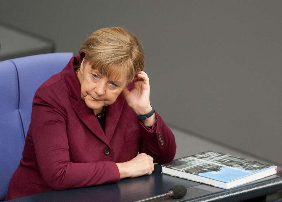 "German Chancellor Angela Merkel attends a session of the German parliament Bundestag where lawmakers are debating a range of proposals to regulate assisted suicide in Berlin, Germany, Friday, Nov. 6, 2015. Merkel supports a middle-of-the-road version, proposing up to three years in jail for anyone who offers suicide to someone else ""on business terms."" (Klaus-Dietmar Gabbert/dpa via AP) Photo: Klaus-Dietmar Gabbert, Associated Press"