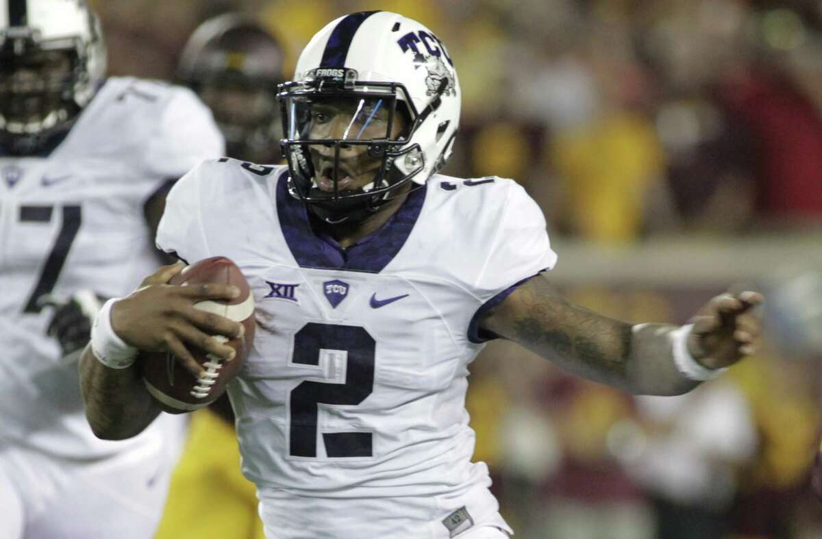 TCU quarterback Trevone Boykin runs against Minnesota in Minneapolis on Sept. 3, 2015. TCU is at Oklahoma State in the first of several huge games in the Big 12 in November. Both the Horned Frogs and Cowboys are undefeated and averaging more than 40 points per game.