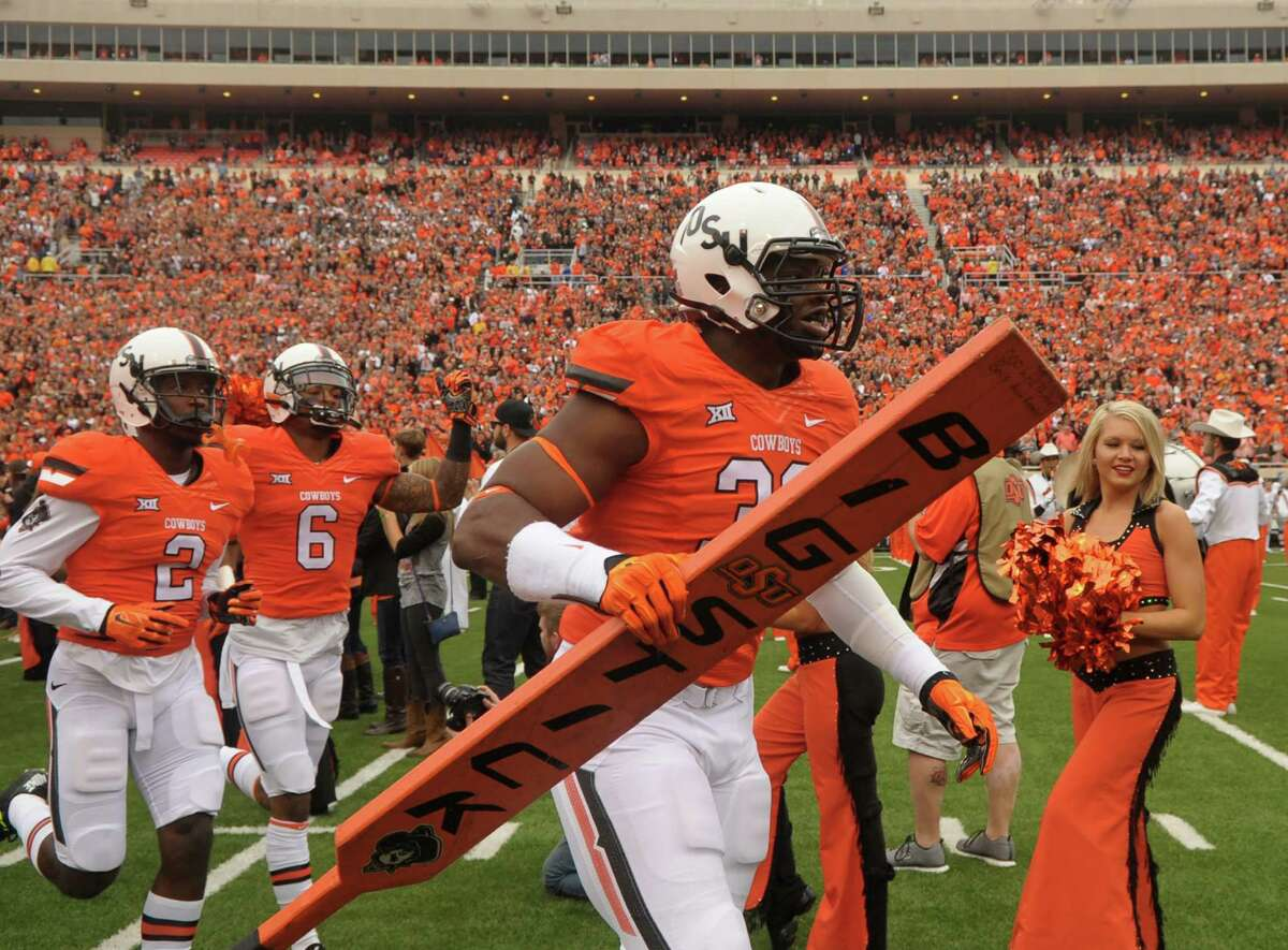 Oklahoma State defensive end Emmanuel Ogbah carries the team's