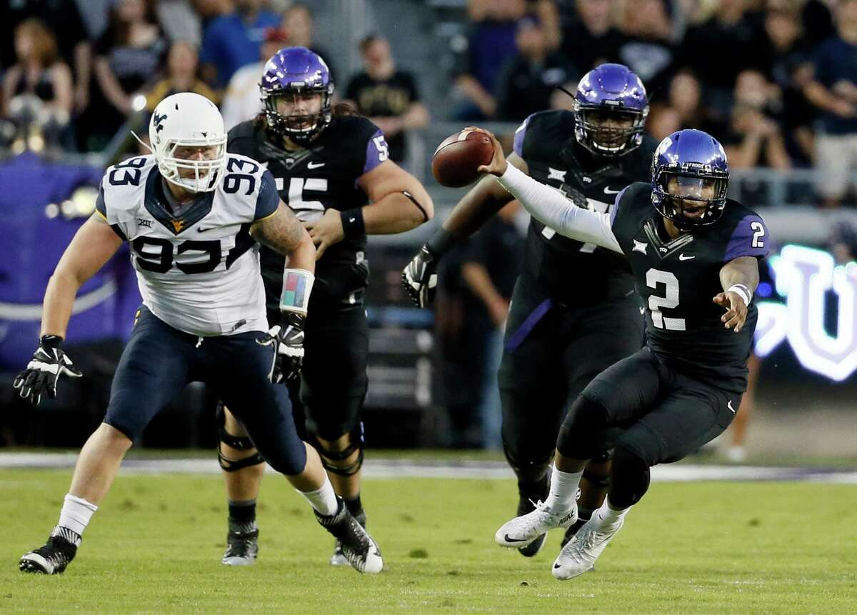TCU quarterback Trevone Boykin scrambles out of the pocket under pressure from West Virginia's Kyle Rose (93) in the first half on Oct. 29, 2015, in Fort Worth.