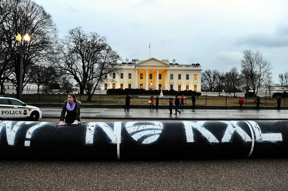 (FILES) This February 3, 2014 file photo shows environmental activists as they inflate a long balloon to mock a pipeline during a demonstration in front of the White House in Washington, DC,to protest against the Keystone pipeline project. US President Barack Obama on November 6, 2015 blocked the construction of a controversial Keystone XL oil pipeline between Canada and the United States, ending years of bitter and politically charged debate. AFP PHOTO/JEWEL SAMADJEWEL SAMAD/AFP/Getty Images Photo: Jewel Samad, AFP / Getty Images