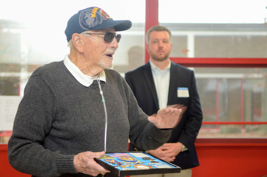 Jerry Hollander, Mamaroneck NY, recounts his experiences as a marine in Korea and Viet Nam. Turn of River Middle School students honor military veterans with a breakfast and presentations in Stamford, Conn. on Nov. 6, 2015. The celebratory morning is the culmination of a social studies unit conducted every year for the past eight years, launched by eighth grade U.S. history teacher Heather Lorenz, whose father served in the marine corps. Photo: Sheley Cryan /For Hearst Connecticut Media / Stamford Advocate Freelance
