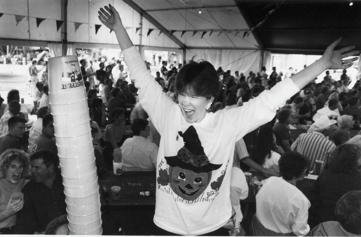 Kathy Grider from Grand Prairie celebrates after putting another cup on the stack in 1992.