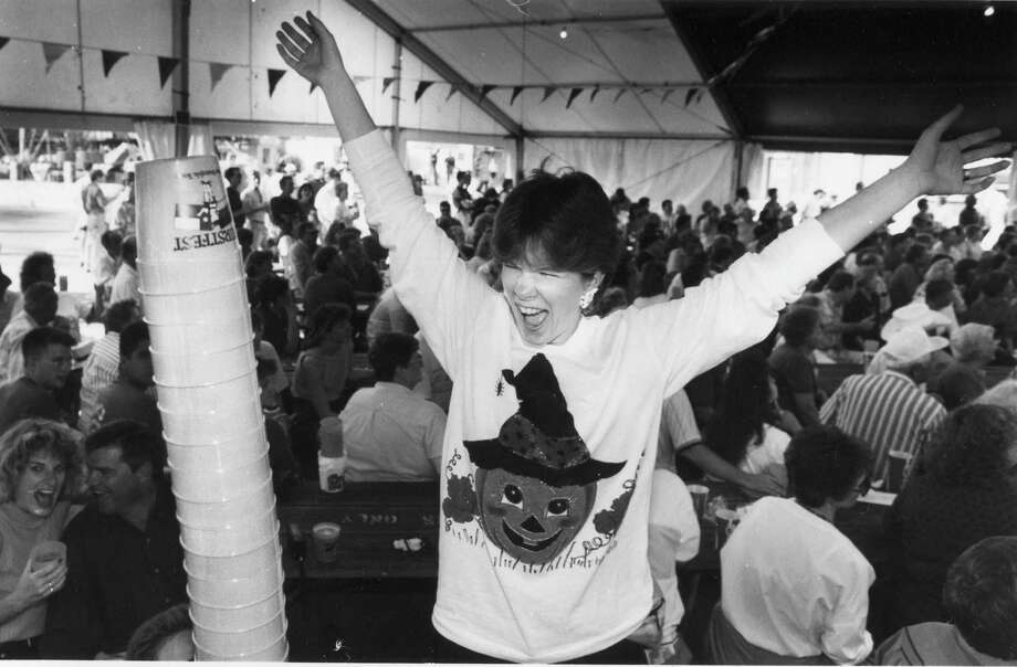 Kathy Grider from Grand Prairie celebrates after putting another cup on the stack in 1992. Photo: San Antonio Express-News