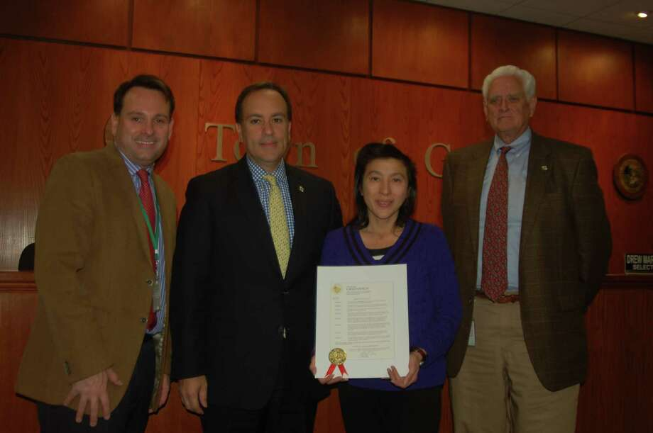 From left, Selectman Drew Marzullo, First Selectman Peter Tesei and Selectman John Toner present a proclamation from the town to Ruth Shu, of the Pancreatic Cancer Action Network declaring November to be pancreatic cancer awareness month. Photo: / Ken Borsuk