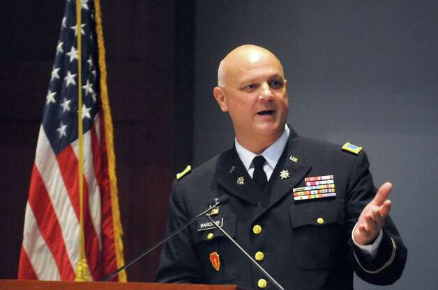 Colonel Michael J. Barcomb, College of Saint Rose graduate class of 1987, gives the keynote address during a dedication ceremony for The College of Saint Rose Veteran Center on Friday Nov. 6, 2015 in Albany, N.Y.  (Michael P. Farrell/Times Union) Photo: Michael P. Farrell / 00034082A