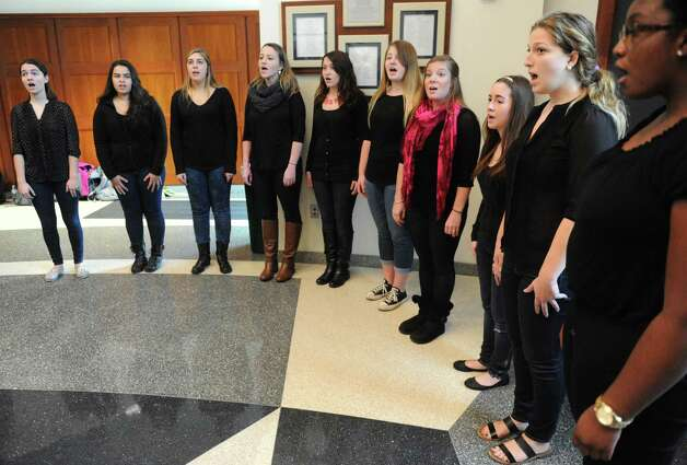 The College of Saint Roes a cappella group, The Girls Next Door, perform the national anthem during a dedication ceremony for The College of Saint Rose Veteran Center on Friday, Nov. 6, 2015, in Albany, N.Y.  (Michael P. Farrell/Times Union)) Photo: Michael P. Farrell / 00034082A