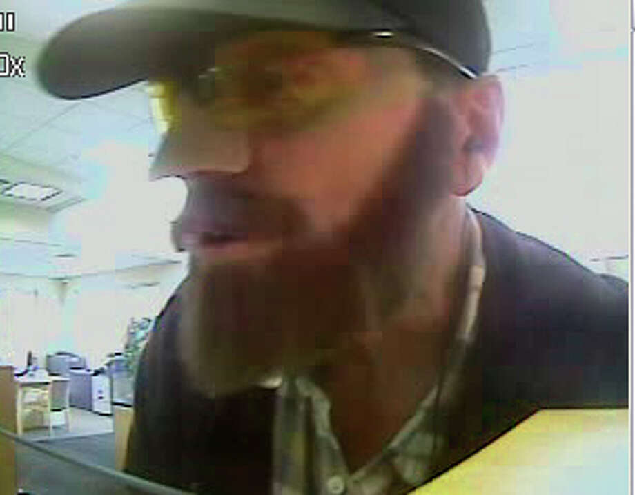 "The ""Beardo"" bank robber is alleged to have robbed Washington Federal Savings on 19th Avenue Southeast in Everett on Sept. 2, pictured. Photo: Courtesy FBI"