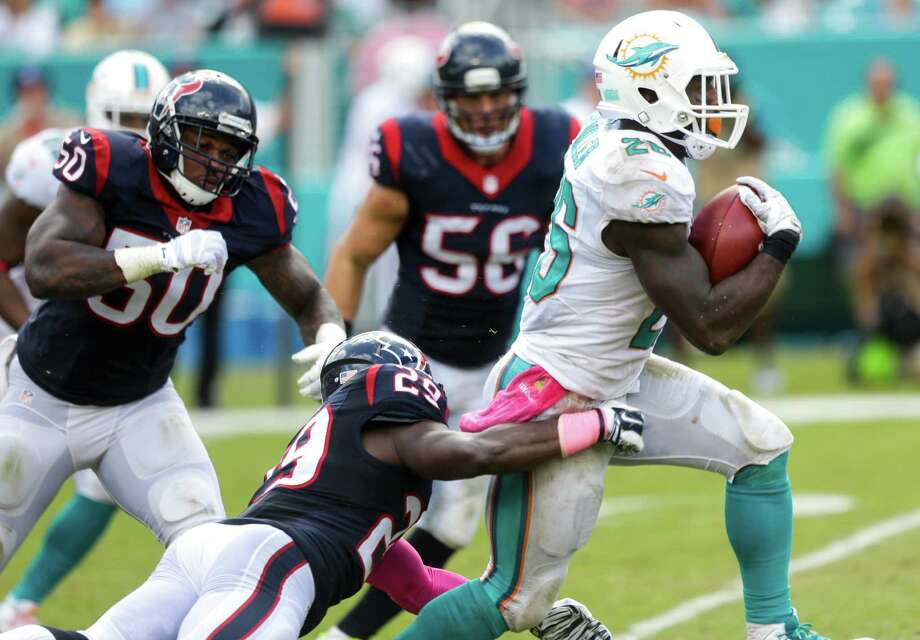 Running back Lamar Miller is a nice addition for the Texans, but he and QB Brock Osweiler don't immediately make them a contender, says Jerome Solomon. Photo: Brett Coomer, Staff / © 2015  Houston Chronicle